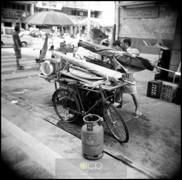 Couple packing up their mobile store after a morning of work in the street market